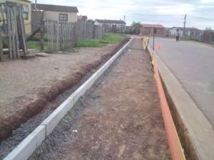 16 - Construction of Asphalt sidewalks - Kerbing